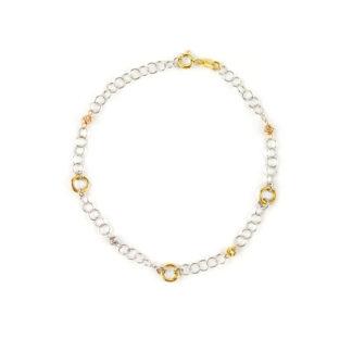 Bracciale lineare oro bianco 750 con elementi a cerchio in oro giallo, lisci e lucidi, alternati da palline in oro bianco, giallo e rosa