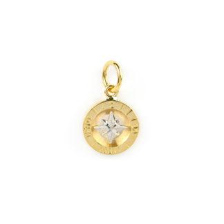 Rosa dei venti oro, ciondolo in oro giallo tit 750 (18 kt) con rosa dei venti in oro bianco; diametro del ciondolo 14 mm; lunghezza totale 2,40 cm